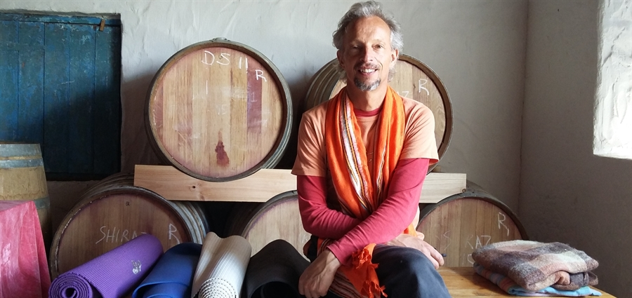 Yogi Johann with wine vats and yoga mats